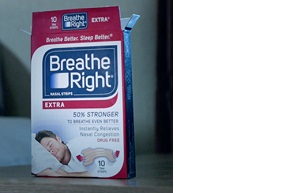 A new box of Breathe Right Nasal Strips Extra holding eight strips.