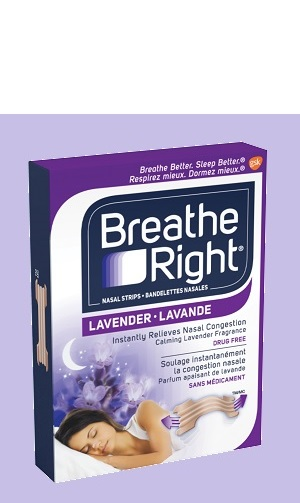 A new box of Breathe Right Lavender Scented Nasal Strips sitting on a pillow surrounded by flowers.